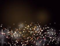 Das abstrakte Funkeln spielt goldenen Feiertags-Hintergrund bokeh Effekt die Hauptrolle Lizenzfreie Stockbilder