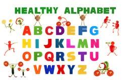 Das Alphabet, das in mehrfarbigen Plastik geschrieben wird, scherzt Buchstaben Lizenzfreie Stockfotos