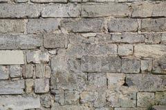 Das alte Gebäude ist eine Wand, die von der Steinmaurerarbeit hergestellt wird Stockfotos
