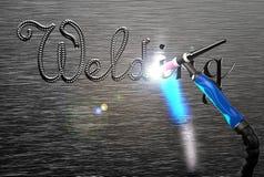 Das Aufschriftschweißen, tig-Schweißensgriff auf einer Metallplatte Stockfotos