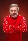 Das ausdrucksvolle Porträt auf rotem Hintergrund eines Poutermannes Lizenzfreies Stockbild