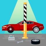 Das Auto hob auf den Aufzug und eine Schüssel für Schmierölwiedereinbau an Auto-Reparaturen und Diagnosen Selbstwartung Lizenzfreie Stockfotos
