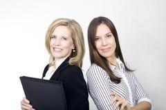 Das Büromädchen und die Dame Boss Stockfotografie