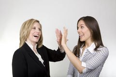 Das Büromädchen und die Dame Boss Stockfoto