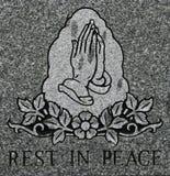 Das Beten übergibt Radierung mit Rest in der Friedensbeschreibung Stockfotografie