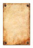 Das Blatt eines alten Papiers wird durch Nägel angebracht stockbilder