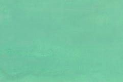 Das Blatt Papier wird heraus durch eine grüne Gouache gemalt Lizenzfreies Stockfoto