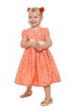 Das blonde Mädchen im langen rosa Kleid Stockfotos