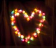 Das bunte Glühen kreist Bokeh auf einem dunklen Hintergrund ein Lizenzfreie Stockfotografie