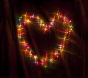Das bunte Glühen kreist Bokeh auf einem dunklen Hintergrund ein Lizenzfreies Stockfoto