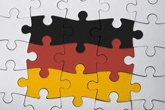 Das deutsche Puzzlespiel lizenzfreie stockbilder