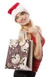Das Einkaufstaschemädchen im Weihnachten Stockfotos