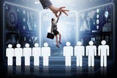 Das Einstellungskonzept mit der Hand, die den besten Angestellten auswählt Lizenzfreies Stockfoto