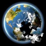 Das Erde-Puzzlespiel Stockbilder
