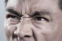 Das Extrem, das oben auf verärgertem nah ist, bemannt Gesicht lizenzfreie stockfotos