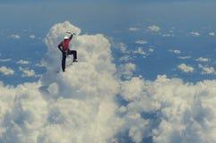 Das extreme Klettern ist seine Adrenaline Gemischte Medien Stockfoto