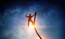 Das extreme Klettern ist seine Adrenaline Gemischte Medien Lizenzfreies Stockbild