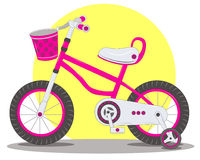 Das Fahrrad der rosa Kinder Stockfotos