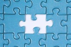 Das fehlende Stück in einem Puzzlespiel Stockfotos
