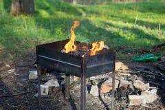 Das Feuer, das im Messingarbeiter brennt Lizenzfreie Stockbilder