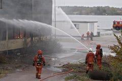 Das Feuer heraus setzen Stockfotos