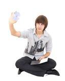 Das Foto des jungen Mannes ein cd dvd anhalten trennte Stockbild