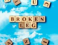 Das gebrochene Bein des Wortes Stockbild