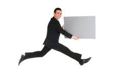 Das Geschäftsmannspringen Stockbilder