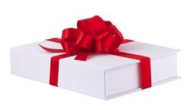 Das Geschenk mit rotem Farbband Lizenzfreies Stockbild
