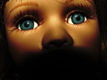 Das Gesicht der Spielzeugpuppe. gefärbt Lizenzfreie Stockbilder