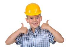 Das glückliche Kind, das Daumen herstellt, up Geste und das Betrachten der Kamera stockbild