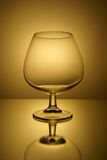 Das Glas in der Hintergrundbeleuchtung Stockbilder