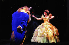 Das goldene Micky Erscheinen - Schönheit und das Tier Lizenzfreie Stockbilder