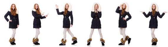 Das hübsche Mädchen in der warmen Kleidung lokalisiert auf Weiß lizenzfreies stockfoto