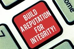 Das Handschriftstextschreiben bauen ein Ansehen für Integrität auf Konzeptbedeutung erreichen das gute Feedback, das auf Ethik Ta stockbilder