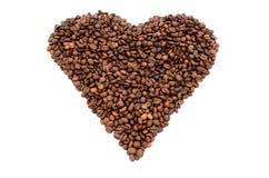 Das Herzsymbol gemacht von den Kaffeebohnen Lizenzfreie Stockbilder