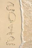 Das Jahr 2012 geschrieben in Sand auf Strand Lizenzfreies Stockbild