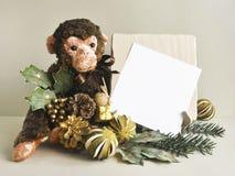 2016 - das Jahr des Affen Spielzeugaffe Stockbild