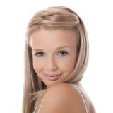 Das junge blonde Mädchen mit dem schönen Haar stockbild