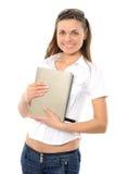 Das junge Mädchen mit dem langen Haar und dem Buch Lizenzfreies Stockfoto