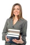 Das junge Mädchen mit dem langen Haar und dem Buch Lizenzfreie Stockfotos