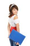 Das junge Mädchen mit einem Faltblatt Stockfotos