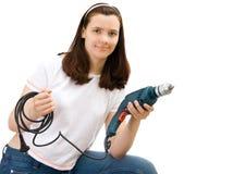 Das junge Mädchen mit Gebäudebohrgerät Stockbild