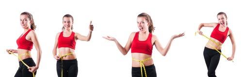 Das junge Mädchen mit Zentimeter Stockfotos