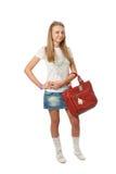 Das junge schöne Mädchen mit einem Beutel Stockfoto