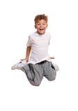 Das Jungenspringen Stockbilder