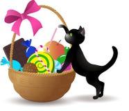Das Kätzchen nahe bei dem Korb von Bonbons Lizenzfreie Stockfotografie