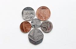 Das königliche Schild von Münzen des Pfunds stockfotos