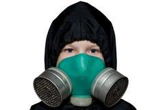 Das Kind in der chemischen Schutzklage Stockbild