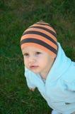 Das Kind in einer Schutzkappe Lizenzfreies Stockfoto